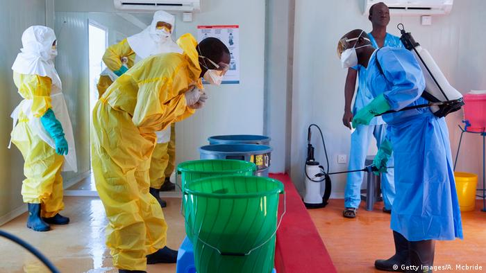 UNICEF staff members clean themselves during a training session on Ebola infection prevention, in Juba, South Sudan, on February 21, 2019