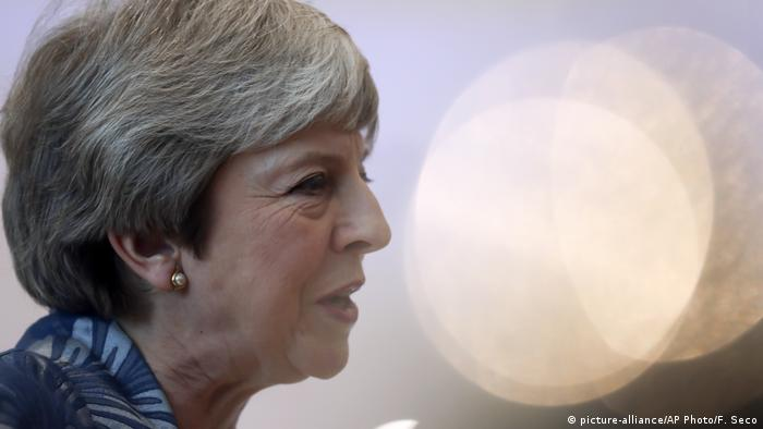 British Prime Minister Theresa May speaks with the media as she arrives for an EU-Arab summit at the Sharm El Sheikh convention center