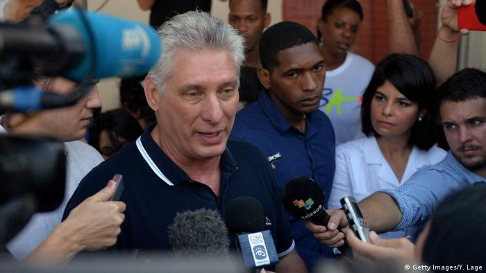 Miguel Diaz-Canel speaking to the press after voting on a constitutional referendum