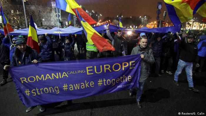 Protesters carry a banner during a demonstration against judicial changes in Bucharest, Romania