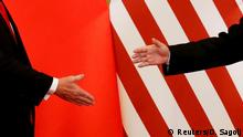 FILE PHOTO: U.S. President Donald Trump and China's President Xi Jinping shake hands after making joint statements at the Great Hall of the People in Beijing, China, November 9, 2017. REUTERS/Damir Sagolj/File Photo/File Photo/File Photo