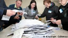 Members of a local electoral commission count votes following a parliamentary election in Chisinau, Moldova February 24, 2019. REUTERS/Vladislav Culiomza