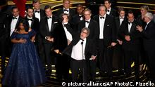 Peter Farrelly, center, and the cast and crew of Green Book accept the award for best picture at the Oscars on Sunday, Feb. 24, 2019, at the Dolby Theatre in Los Angeles. (Photo by Chris Pizzello/Invision/AP)