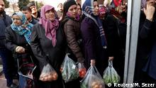 FILE PHOTO: People wait in line to buy vegetables sold in a tent set up by the municipality in the Bayrampasa district of Istanbul, Turkey, February 11, 2019. REUTERS/Murad Sezer/File Photo