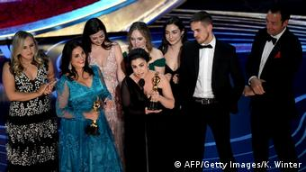 The team that won the Oscars: Melissa Berton (center, left) and Rayka Zehtabchi (center, right)