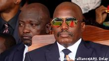 Outgoing president Joseph Kabila sits during the inauguration ceremony for Congolese President Felix Tshisekedi in Kinshasa, Democratic Republic of the Congo, Thursday Jan. 24, 2019. Tshisekedi won an election that raised numerous concerns about voting irregularities amongst observers as the country chose a successor to longtime President Kabila. (AP Photo/Jerome Delay)
