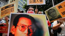 Activists hold pictures of Liu Xiaobo during a protest outside the Chinese government's liaison office in Hong Kong Sunday, Aug. 23, 2009, demanding the release of Liu, a key figure among the series of dissidents Beijing has detained ahead of the 60th anniversary of communist rule on Oct. 1. (AP Photo/Vincent Yu)