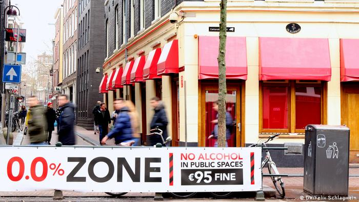 """A poster bears the words, """"0.0 percent zone."""" It refers to the ban on drinking alcoholic beverages in public in Amsterdam's city center"""