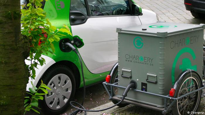 An electric car being charged at a mobile charging station