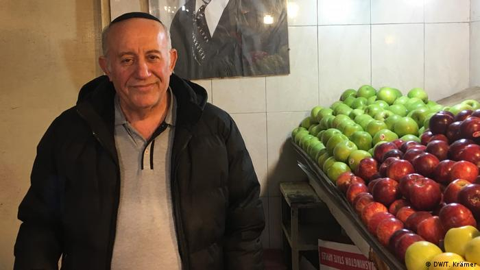 Abraham Levy who sells fruit at a market in Jerusalem