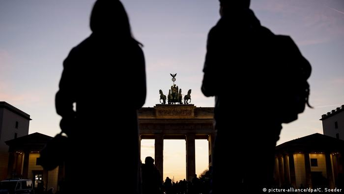 Backpackers by the Brandenburg Gate