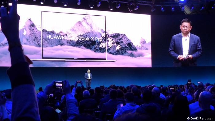 A Huawei executive introduces the company's new notebook Matebook X Pro to an audience at the MWC in Barcelona