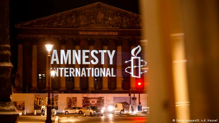 The logo of NGO Amnesty International is projected onto the Palais Bourbon, the seat of the French national assembly