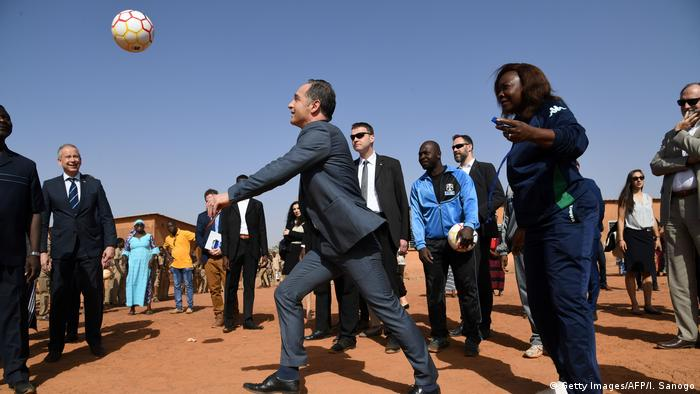 German foreign minister Heiko Maas plays with school children during his visit in Burkina Faso.