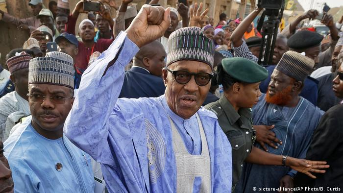 Muhammadu Buhari with his fist raised