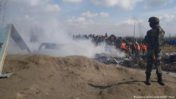 Indian security guards at a crash site of an aircraft