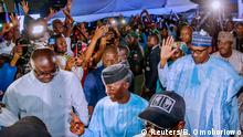 Nigeria's President Muhammadu Buhari greets his supporters at the campaign headquarters of All Progressives Congress (APC) in Abuja, Nigeria February 27, 2019. Bayo Omoboriowo/Nigeria Presidency/Handout via Reuters ATTENTION EDITORS - THIS IMAGE WAS PROVIDED BY A THIRD PARTY NO RESALES. NO ARCHIVE.