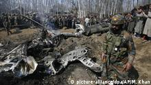 An Indian army solider walks past the wreckage of an Indian aircraft after it crashed in Budgam area, outskirts of Srinagar, Indian controlled Kashmir, Wednesday, Feb.27, 2019. (AP Photo/Mukhtar Khan) |