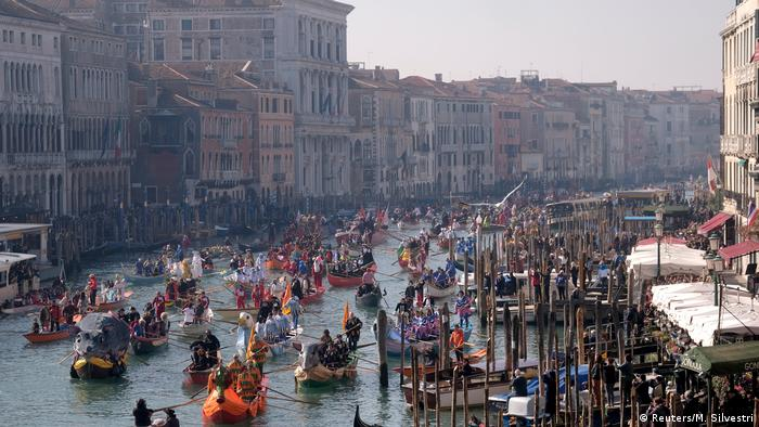 The carnival season starts with a parade down the Grand Canal