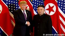 In this image made from video, U.S. President Donald Trump, left, meets North Korean leader Kim Jong Un at Metropole Hotel in Hanoi, Vietnam, Wednesday, Feb. 27, 2019. (Host Broadcast via AP) |