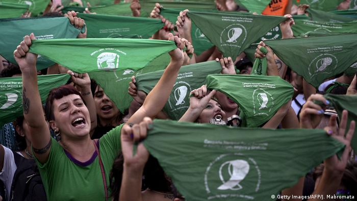 Activists holding up green bandanas demonstrate in favor of legalizing abortion (Getty Images/AFP/J. Mabromata)