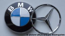 GERMANY, BONN - FEBRUARY 25: Collaboration - joint venture in mobility services between Daimler AG and the BMW Group. The picture shows the logos of Daimler AG (Mercedes Benz) and the BMW Proup. | Keine Weitergabe an Wiederverkäufer.