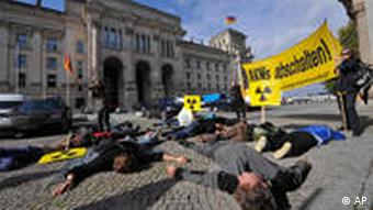 Protesters conducting a die-in against nuclear power plants