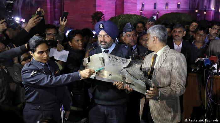 Indian Air Force officials display a wreckage of a missile that they say was fired by Pakistan Air Force fighter jet during a strike over Kashmir on Wednesday.