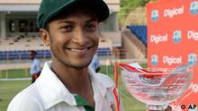 FILE - In this July 20, 2009 file photo, Bangladesh's cricket captain Shakib Al Hasan poseS with the trophy after his team's victory over the West Indies in the fourth day of the second cricket Test at the National Stadium in St. George's, Grenada. Hasan has been voted The Wisden Cricketer magazine's 2009 world test player of the year on Thursdaay, Oct. 8, 2009. (AP Photo/Andres Leighton, File)