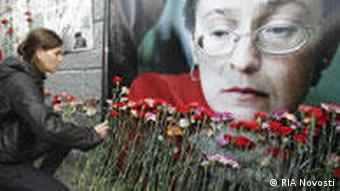 People laying flowers at the apartment building where the journalist Anna Politkovskaya lived. RIA Novosti 7.10.2009