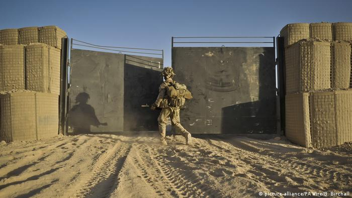 The last soldier in a patrol from the 1st Battalion Royal Regiment Fusiliers goes through the gate at his base
