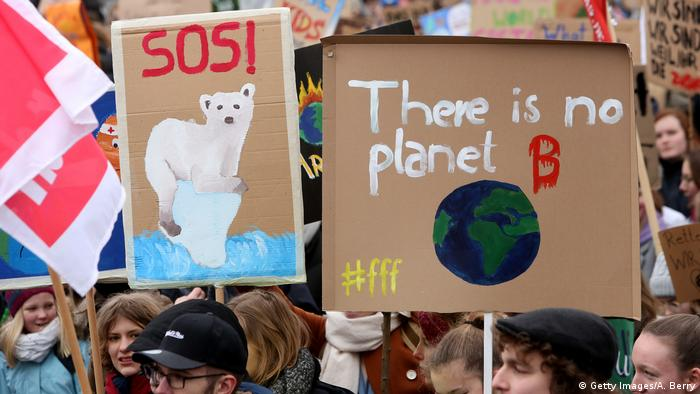 A protester in Hamburg hold up a sign reading There is no planet B
