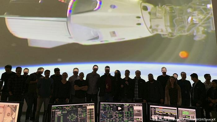 SpaceX technicians watch the Dragon docking with the ISS station in March