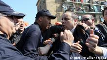 epaselect epa04121807 Chairman of Jil Jadid (New Generation) Party, Soufiane Djilali (C) clashes with riot police officers during a protest against Algerian President Abdulaziz Bouteflika's decision to run for a fourth term, in Algiers, Algeria, 12 March 2014. A dozen candidates have registered to contest Algeria's upcoming presidential election, including the ailing 77-year-old incumbent, Abdelaziz Bouteflika. Elections are scheduled for 17 April. EPA/STR |