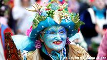A carnival reveller in a costume is seen before the Rosenmontag (Rose Monday) parade in Cologne, Germany, March 4, 2019. REUTERS/Thilo Schmuelgen