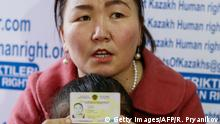 Gulzira Auelkhan, who spent close to two years trapped in China, speaks during an AFP interview at the office of the Ata Jurt rights group in Almaty, Kazakhstan, on January 21, 2019. She is pictured with her five-year-old daughter. (Photo by Ruslan PRYANIKOV / AFP) (Photo credit should read RUSLAN PRYANIKOV/AFP/Getty Images)