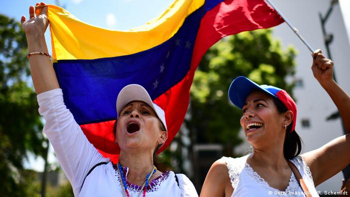Venezuelan national flags were waved ahead of Guaido's arrival