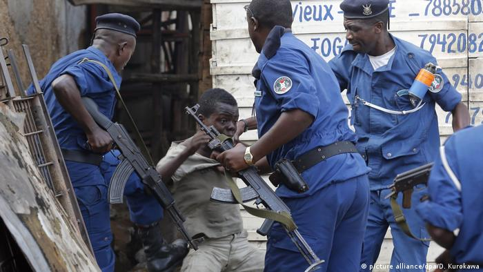 Burundian police round up a young protester