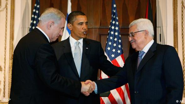 President Barack Obama watches as Israeli Prime Minister Benjamin Netanyahu and Palestinian President Mahmoud Abbas shake hands, Sept. 22, 2009 (AP Photo/Charles Dharapak, File)