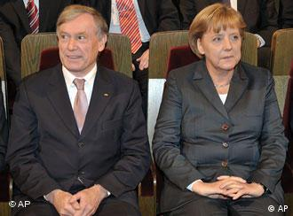President Koehler and Chancellor Merkel sitting together