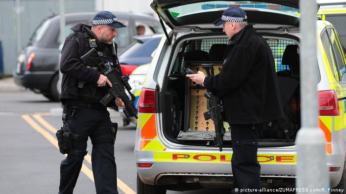Armed police at London City Airport after reports of a suspicious package