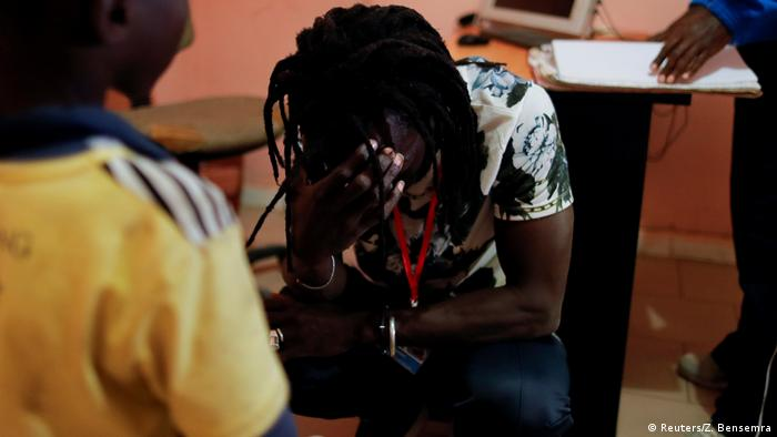 Issa Kouyate, the founder of Maison de la Gare, cries while talking to an eight-year-old talibe boy, whom he rescued (Reuters/Z. Bensemra)