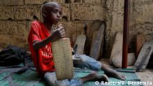 Omar Wone, 8, from Futa, a Koran student, called a talibe, sits on the floor of the daara (Koranic school) where he lives and learns Koran in Saint-Louis, Senegal, February 8, 2019. Omar was complaining about chest pain. REUTERS/Zohra Bensemra SEARCH TALIBE BENSEMRA FOR THIS STORY. SEARCH WIDER IMAGE FOR ALL STORIES. Story: https://reut.rs/2tyIpVb