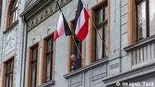 The Reichs flag flown out of an apartment window