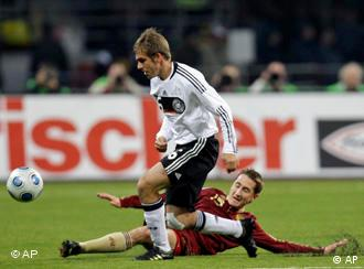 Germany's Philipp Lahm, front, fights for the ball with Russia's Vladimir Bystrov