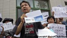 China Peking - Jiang Huis Mutter war an Bord der verschwundenen Malaysia Airline Maschine MH370