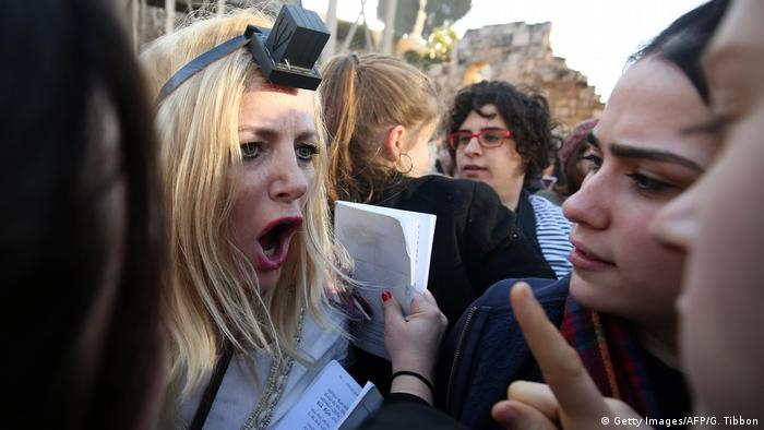 A member of the Women of the Wall movement argues with ultra-Orthodox Jewish girls who interrupted a prayer event at the Western Wall in Jerusalem