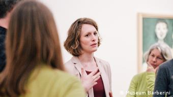 Valerie Hortolani speaking at a press conference at the Barberini Potsdam
