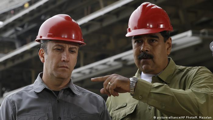 Tareck El Aissami (left) with acting President Nicolas Maduro