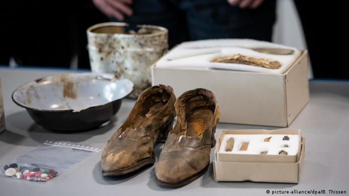 Artifacts including shoes, buttons and bowls